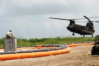 Louisiana National Guard's 1023rd Vertical Engineer Co. completed construction of a Tiger Dam water diversion system
