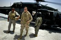 U.S. Navy Adm. Mike Mullen, chairman of the Joint Chiefs of Staff, arrives on Camp Nathan Smith in Kandahar, Afghanistan