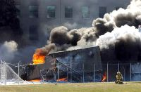 Firefighters work to put out the flames moments after a hijacked jetliner crashed into the Pentagon, Sept. 11, 2001