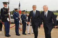 Defense Secretary Robert M. Gates, right, accompanies French Defense Minister Herve Morin upon his arrival at the Pentagon