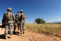 Army Maj. Gen. Peter Aylward, special assistant to the chief of the National Guard Bureau, center, speaks with Arizona Army National Guard soldiers near Nogales, Ariz., while visiting troops serving along the Southwest border in support of U.S. Customs and Border Patrol agents, Sept. 13, 2010