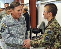 Army Gen. David Petraeus, International Security Assistance Force and U.S. Forces-Afghanistan commander, meets with an Afghan National Army soldier who works at the detention facility in Parwan, Afghanistan, Sept. 27, 2010. The facility is operated by more than 100 Afghan soldiers and 1,200 military members from the U.S. Army, U.S. Air Force, U.S. Navy and U.S. Marine Corps guard force, medical and legal support fields. More than 600 additional Afghan soldiers are being trained for their assumption of guard force responsibilities. U.S. Air Force photo by Senior Airman William A. O'Brien