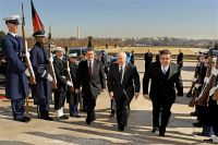 Defense Secretary Robert M. Gates, center, escorts Afghan Interior Minister Bismullah Mohammadi, left, and Defense Minister Abdul Rahim Wardak, right, into the Pentagon for a security consultation forum, Feb. 23, 2011