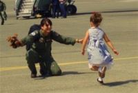 Navy Lt. Tiffani Walker and her daughter rush to embrace. Courtesy photo